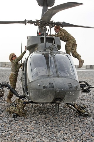 Chief Warrant 4 Anne Wiley (left), the senior standardizations instructor pilot for 7th Squadron, 17th Cavalry Regiment, and Capt. Carmel Cammack, an assistant operations officer for the unit, both OH-58D Kiowa pilots, conduct pre-flight inspections on their aircraft at Kandahar Air Field, Afghanistan. (Photo by Sgt. 1st Class Stephanie Carl)