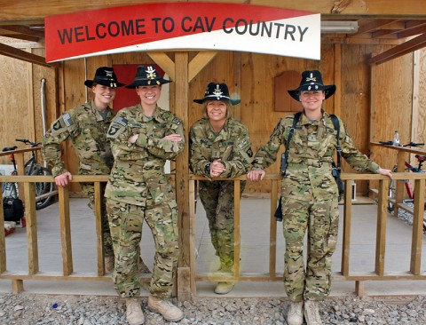 From left to right: Capt. Carmel Cammack, Capt. Donna J. Buono, Chief Warrant Officer 4 Anne Wiley, and Chief Warrant Officer 2 Elizabeth Kimbrough, all leaders within Task Force Palehorse, join for a group shot in outside the task force's operation center at Kandahar Air Field. (Photo by Sgt. 1st Class Stephanie Carl)