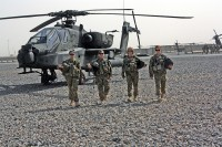 From left to right: Chief Warrant Officer 2 Elizabeth Kimbrough, Capt. Donna J. Buono, Chief Warrant Officer 4 Anne Wiley, and Capt. Carmel Cammack, all leaders within Task Force Palehorse, join for a group shot in front of an AH-64 Apache at their landing pads on Kandahar Air Field. All four of the women fly either Apaches or OH-58D Kiowas. Wiley serves as the unit's senior standardization instructor pilot and is the first to hold that position at a squadron level.