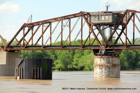 The swollen Cumberland River rushing past the Old Railroad Bridge at Riverside Drive, Clarksville TN.