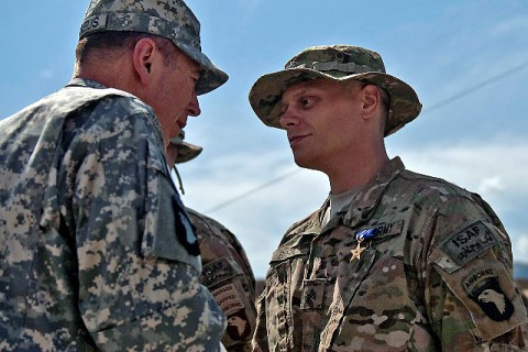 U.S. Army Gen. David H. Petraeus, International Security Assistance Forces commander, awards a Silver Star Medal to U.S. Army Sgt. Joshua L. Bostic, an infantry squad leader from Spring City, TN, assigned to Task Force No Slack, 1st Brigade Combat Team, 101st Airborne Division, at Forward Operating Base Joyce in eastern Afghanistan's Kunar Province April 11th. (Photo by U.S. Army Sgt. 1st Class Mark Burrell, Task Force Bastogne Public Affairs)