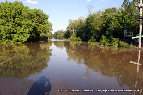 Dubar Cave Road is under a sea of brown water