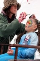A young girl gets her face painted