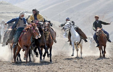 Chapandaz, or Buzkashi players, fight for a calf carcass during a Buzkashi game in Paryan District, April 7th. More than 1,000 people including local Afghan villagers and Panjshir Provincial Reconstruction Team members attended the event. The chapandaz and their horses go through rigorous training before competing in the game. (Photo by U.S. Air Force Senior Airman Amber Ashcraft, Panjshir Provincial Reconstruction Team Public Affairs)