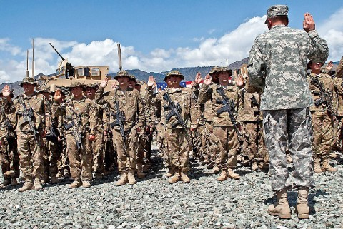 U.S. Army Gen. David H. Petraeus, International Security Assistance Forces commander, recites the oath of re-enlistment to 113 Soldiers assigned to 2nd Battalion, 327th Infantry Regiment, Task Force No Slack, 1st Brigade Combat Team, 101st Airborne Division, at Forward Operating Base Joyce in eastern Afghanistan's Kunar Province April 11th. (Photo by U.S. Army Sgt. 1st Class Mark Burrell, Task Force Bastogne Public Affairs)