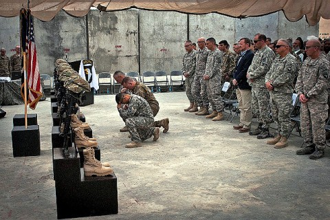 Three U.S. Army chaplains from 101st Airborne Division, kneel give a final prayer during a memorial service for six of their fallen comrades at Forward Operating Base Joyce April 9th. The six U.S. Soldiers, all assigned to 2nd Battalion, 327th Infantry Regiment, Task Force No Slack, were remembered by personal stories from their leaders and battle buddies. (Photo by U.S. Army Sgt. 1st Class Mark Burrell, Task Force Bastogne Public Affairs)