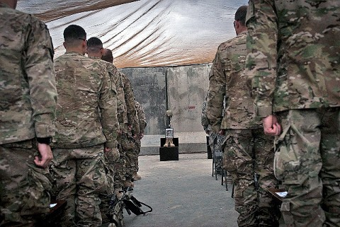Soldiers from 2nd Battalion, 327th Infantry Regiment, Task Force No Slack, 1st Brigade Combat Team, 101st Airborne Division, stand at attention during a memorial service for six of their fallen comrades at Forward Operating Base Joyce April 9th. The six U.S. Soldiers all died during Operation Strong Eagle III in Marawara District March 29th. (Photo by U.S. Army Sgt. 1st Class Mark Burrell, Task Force Bastogne Public Affairs)
