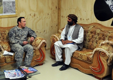 Hami Dullha, the Paktika Province's director of the Department of Agriculture, Irrigation, and Livestock, discusses progress of the province's watershed program with U.S. Army Maj. Stephen L. Battle, the civil affairs officer from 4th Brigade Combat Team, 101st Airborne Division, during his visit April 9th at Forward Operating Base Sharana in Paktika Province, Afghanistan. (Photo by U.S. Army Spc. Kimberly K. Menzies, Task Force Currahee Public Affairs)