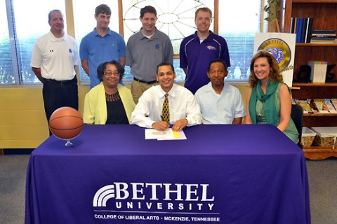 Travis Russell signs Basketball Scholarship with Bethel University
