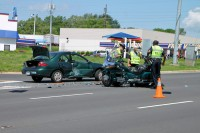 Motorcycle collides with Ford Escort. (Photo by CPD-Jim Knoll)