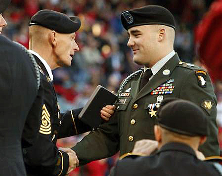 Command Sgt. Maj. Eric Crabtree, 1st Battalion, 187th Infantry Regiment, congratulates former Spc. Daniel Foster after the presentation of a Silver Star medal at Angel Stadium in Anaheim CA, April 9th. Foster earned the medal during a deployment to Afghanistan in support of Operation Enduring Freedom.