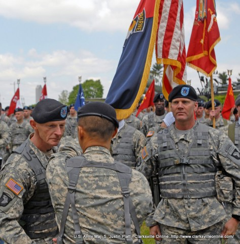 U.S. Army Command Sgt. Maj. Eric Crabtree,  3rd Brigade Combat Team, 101st Airborne Division (Air Assault) incoming Command Sergeant Major,  receives the brigade colors from 3rd Brigade Commander U.S. Army Col. Viet Luong at the Fort Campbell Pylon, 4 May. The brigade conducted a change of responsibility ceremony, where Crabtree formally took responsibility for the welfare, training, and professional development of the brigade's Soldiers from  U.S. Army Command Sgt. Maj. Greg Patton. (Photo by U.S. Army Maj. S. Justin Platt)