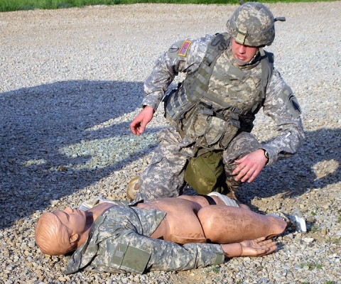 Spc. Robert Pennywitt, an aircraft powerplant repairer with 2nd Battalion, 160th Special Operations Aviation Regiment, Fort Campbell, KY, tests on a first-aid task during the command's annual Noncommissioned Officer and Soldier of the Year Competition. (160th Special Operations Aviation Regiment photo)