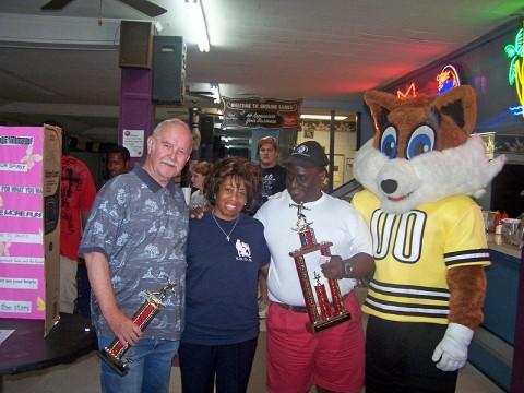 "(Left to Right) 2nd Place winner Walt Telfer, Reverend Rita Ewing, 1st Place winner Fabian Merriweather and ""Trixy"" the Clarksville Fox-Women's football teams mascot."
