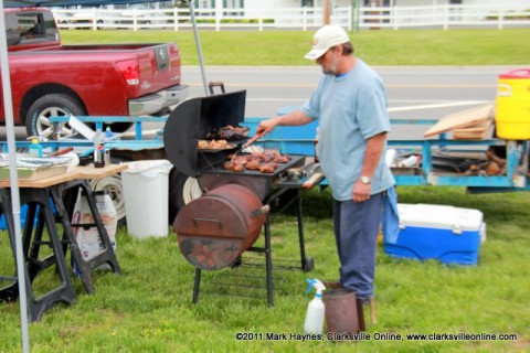 One of the contestants cooking chicken for his entry into the BBQ Cookoff.