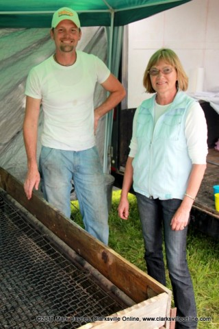 Mike Johnson and Elkie Melton standing next to the BBQ pit used to cook the championship ribs.