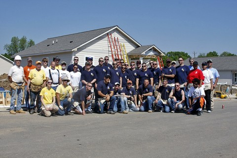 24 members of 3rd Platoon, B Co., 3rd Battalion, 187th Infantry Regiment, 101st Airborne Division, post in front of a nearly-complete home with other Habit for Humanity volunteers May 8th. The paltoon participated in a Mother's Day Habitat for Humanity home build, helping finish the exteriors of four homes on Ewing Drive in Nashville, TN. (U.S. Army Courtsey Photo)