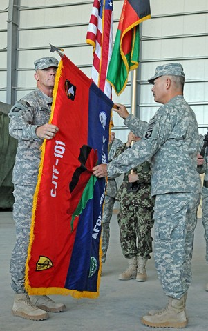 The 101st Airborne Division's colors are uncased by U.S. Army Maj. Gen John Campbell and U.S. Army Command Sgt. Maj. Scott Schroeder, during a transfer-of-authority ceremony at Bagram Airfield, June 14th.