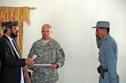 Paktika Province Gov. Habibullah Samim hands a certificate of training to Afghan Uniformed Policeman Wali Jan, the Distinguished Honor Graduate of the AUP's advanced training during a graduation ceremony in Paktika Province, Afghanistan, May 15th. (Photo by U.S. Army Staff Sgt. Matt Graham, Task Force Currahee Public Affairs)