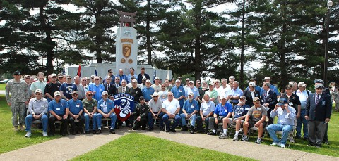 Veterans of the 3rd Brigade Combat Team, 101st Airborne Division gather at a memorial dedicated to fallen Soldiers of the 187th Infantry Regiment.