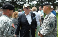 """Colonel Viet Luong, Commander of the 3rd Brigade Combat Team, 101st Airborne Division, speaks with a Vietnam-era Veteran of the brigade during a previous reunion of """"Rakkasan"""" Veterans."""