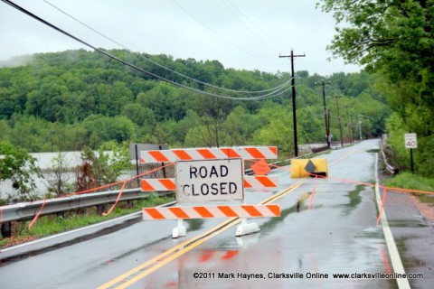Bumpus Mills Road, right next to the Pit Stop Market, closed due to high waters.