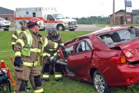 Clarksville Firemen use the jaws of life to extricate Stewart White from his Toyota Corolla. (Photo by Sgt Vince Lewis, CPD)