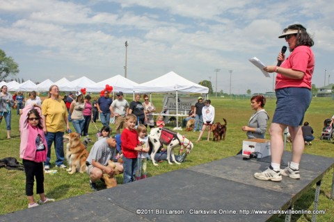 Stacey Hopwood of the Humane Society holds doggy trivia at the 2011 Doggie Palooza