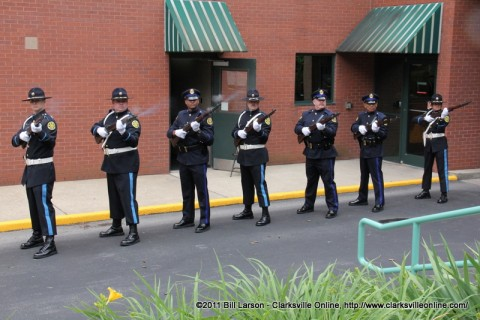 The CPD Honor Guard fires a salute in honor of the fallen police officers