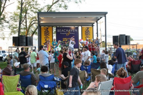 Conch Republic plays as people dance in front of the stage