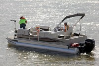 TMS Contracting helping a city employee put out buoys in the Marina Basin using a Crestliner pontoon boat on loan from Bill Roberts Thunder Road Marina.