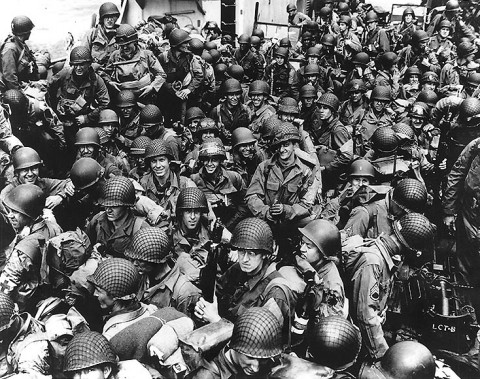 Army troops on board a LCT, ready to ride across the English Channel to France. Some of these men wear 101st Airborne Division insignia. Photograph released 12th June 1944. (Official U.S. Navy Photograph, National Archives.)