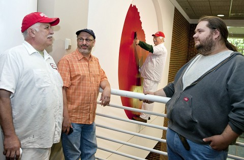 APSU painter Ivan Colon, art professor Gregg Schlanger and art student Tobey Lee stand near the new public art display in the APSU Morgan University Center. (Photo by Beth Liggett/APSU Public Relations and Marketing)