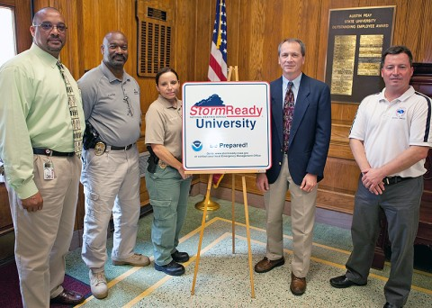 Austin Peay State University Chief of Police Lantz Biles (from left), Lt. Carl Little and Sgt. Georganna Genthner on May 24 receive a sign designating APSU as a StormReady University from Larry Vannozzi, meteorologist in charge with the National Weather Service in Nashville, and Tom Johnstone, also with the NWS Nashville bureau. (Photo by Beth Liggett, APSU Public Relations and Marketing)