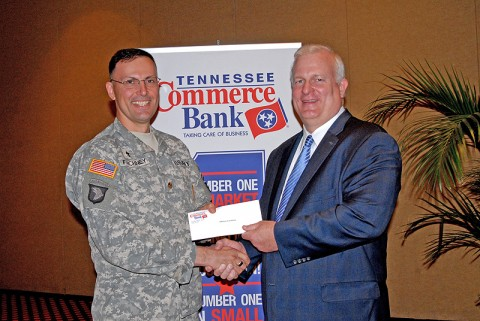 (Left to Right) Chaplain Thomas Faichney receives donation of $500 from Mike Sapp, Tennessee Commerce Bank Chairman/CDO.