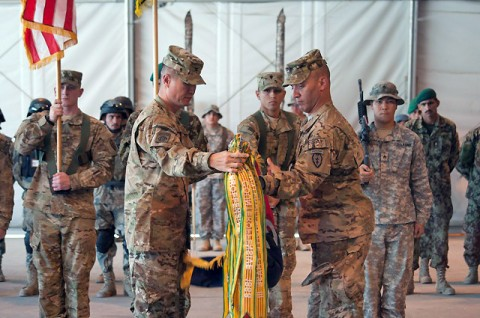 U.S. Army Col. Richard C. Kim, commander of Task Force Bronco, 3rd Brigade Combat Team, 25th Infantry Division, from Honolulu, and U.S. Army Command Sgt. Maj. Andrew J. Spano, command sergeant major of TF Bronco, 3rd BCT, 25th Inf. Div., from Northboro, MA, unfurl their unit colors during the transfer of authority ceremony at Forward Operating Base Fenty, Afghanistan, May 3rd. (Photo by U.S. Army Spc. Hillary Rustine, Task Force Bronco Public Affairs)