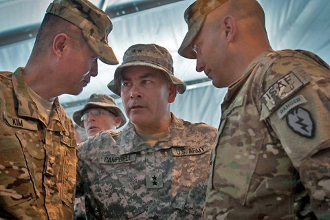 U.S. Army Maj. Gen. John F. Campbell, commander of the 101st Airborne Division and Regional Command-East, relays words of motivation and wisdom to U.S Army Col. Richard C. Kim, commander of Task Force Bronco, and to U.S. Army Command Sgt. Maj. Andrew J. Spano, command sergeant major of TF Bronco after the transfer of authority ceremony at Forward Operating Base Fenty, Afghanistan, May 3rd. (Photo by U.S. Army Sgt. 1st Class Mark Burrell, Task Force Bronco Public Affairs)
