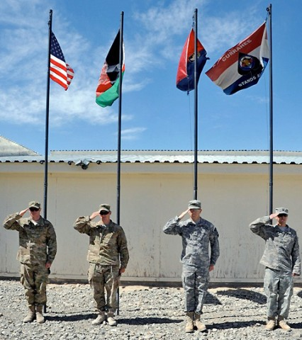 (From Left to Right) U.S. Air Force Senior Airmen Eric Shaner, U.S. Air Force 1st Lt. Lars Swanson, U.S. Army Sgt. Karl Keller,  and U.S. Army Spc. Tommy Rowland, all attached to Task Force Currahee, 4th Brigade Combat Team, 101st Airborne Division render a salute May 21st, in recognition of Armed Forces Day.  (Photo by U.S. Army Sgt. Luther L. Boothe Jr., Task Force Currahee Public Affairs)
