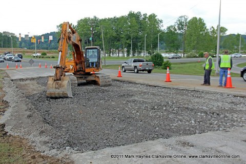 After filling and packing the area with dirt, the Clarksville Street Department is seen here filling the hole with gravel and preparing to reopen the lane on Cumberland Drive.