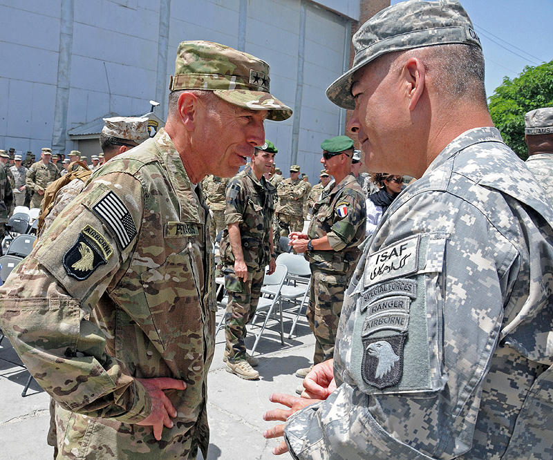General David H. Petraeus, Commander, U.S. Forces Afghanistan, speaks with Maj. Gen. John F. Campbell, Commander, Regional Command – East during the Combined Joint Task Force-101 to Combined Joint Task Force-1 Transfer of Authority ceremony held at Bagram Airfield, Afghanistan May 19th, 2011. The 101st Airborne Division (Air Assault) was deployed in support of Operation Enduring Freedom from June 15th, 2010 to May 19th, 2011.
