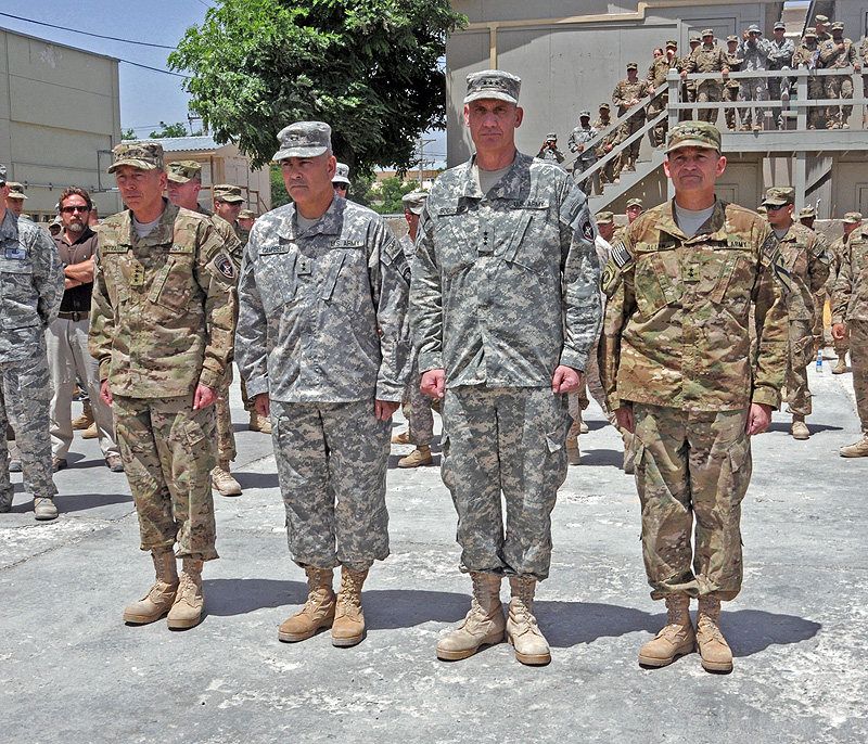 (left to right) General David H. Petraeus, Commander, U.S. Forces-Afghanistan, (outgoing) Maj. Gen. John F. Campbell, Commander, Regional Command – East, Lt. Gen. David M. Rodriguez, Commander, International Security Assistance Force joint Command and Deputy Commander, U.S. Forces-Afghanistan, and (incoming) Maj. Gen. Daniel B. Allyn, Commander, Regional Command – East, line up before marching to the Combined Joint Task Force-101 to Combined Joint Task Force-1 Transfer of Authority ceremony.