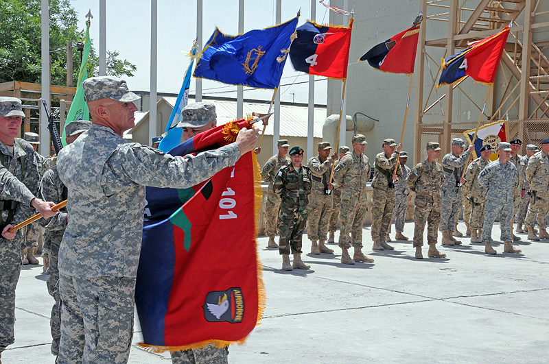 (right) Maj. Gen. John F. Campbell, Commander, Regional Command – East and CSM Scott C. Schroeder, Command Sergeant Major, Regional Command – East cases the colors of the 101st Airborne Division (Air Assault) during the Combined Joint Task Force-101 to Combined Joint Task Force-1 Transfer of Authority ceremony held at Bagram Airfield, Afghanistan May 19th, 2011.