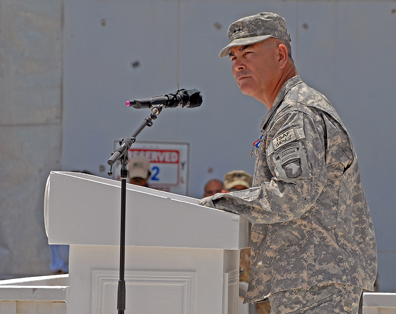 The outgoing commander of Regional Command – East, Maj. Gen. John F. Campbell, 101st Airborne Division (Air Assault) speaks to the crowd during the Combined Joint Task Force-101 to Combined Joint Task Force-1 Transfer of Authority ceremony held at Bagram Airfield, Afghanistan May 19, 2011. The 1st Cavalry Division is taking over operations from the 101st Airborne Division (Air Assault) during their deployment in support of Operation Enduring Freedom.
