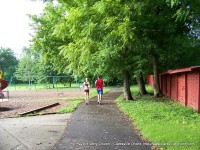 Two joggers make their way around the park on their morning run