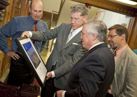 Garry Askew and Tom Bauer, with Bauer Askew Architecture, present APSU President Tim Hall and APSU Provost and Vice President of Academic Affairs Tristan Denley with a framed print of the University's Hemlock Semiconductor Building. (Photo by Beth Liggett/APSU Public Relations)