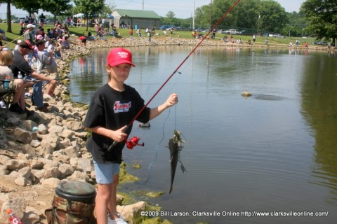 A young girl with her catch at the 2009 Youth Fishing Rodeo in Clarksville, Tennessee