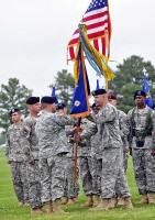 Lt. Col. John Kline, 5th Battalion, 101st Aviation Regiment outgoing commander, passes the battalion colors to Col. Bill Gayler, 101st Combat Aviation Brigade commander, during a change of command ceremony at Fort Campbell, KY, June 22nd. The incoming commander is Lt. Col. Christopher Waters.