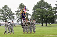 (Left to right) Lt. Col. Christopher Waters, 5th Battalion, 101st Aviation Regiment incoming commander, Maj. Elizabeth Martin, commander of troops and 5th Battalion executive officer, and Lt. Col. John Kline, the outgoing battalion commander, salute the colors during a change of command ceremony at Fort Campbell, KY, June 22nd.
