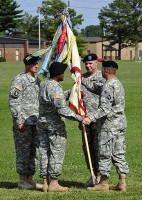 Col. Bill Gayler, 101st Combat Aviation Brigade commander, passes the 96th Aviation Support Battalion Colors to Lt. Col. Benjamin Bahoque, 96th ASB incoming commander, during a change of command ceremony June 20th, at Fort Campbell, KY. (Sgt. Tracy Weeden)