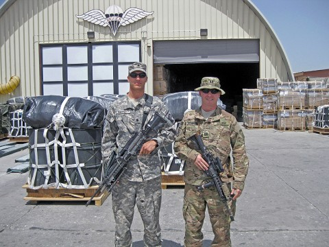 Capt. Ryan Dougherty (right), the battalion fire support officer for the 1-505th Parachute Infantry Regiment, and his brother, Spc. Nathan Dougherty, a rigger with the 11th Quartermaster Detachment, 101st Sustainment Brigade, stand outside the Lifeliner Rigger Shed on Bagram Air Field, Afghanistan. (Photo by Spc. Michael Vanpool)
